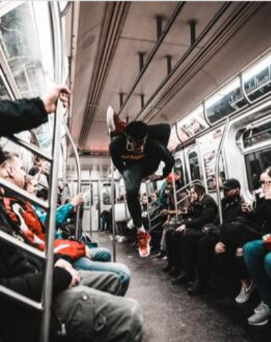 Picture of acrobatic dancer on the subway in New York City